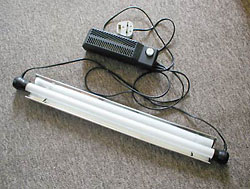 Fig.1 : A fluorescent tube set with a reflector